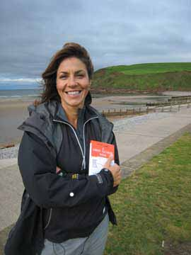 Picture of Julia Bradbury holding her copy of Alfred Wainwright's guide